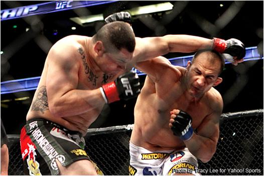 Junior Dos Santos (r.) Strikes Cain Velasquez During Last Night's UFC Heavyweight Title Fight on FOX