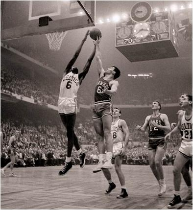 Bill Russell Grabs a Rebound in the 1957 Playoffs