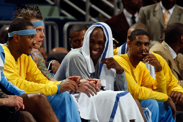 Carmelo Anthony, Chris Andersen, Chauncey Billups And Jason Hart Chill On The Bench In The New Orleans Arena While Their Denver Nuggets Record The Biggest Road Win In NBA Postseason History